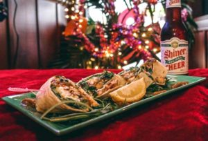 image of a dinner special and a bottle of Shiner Holiday Cheer beer